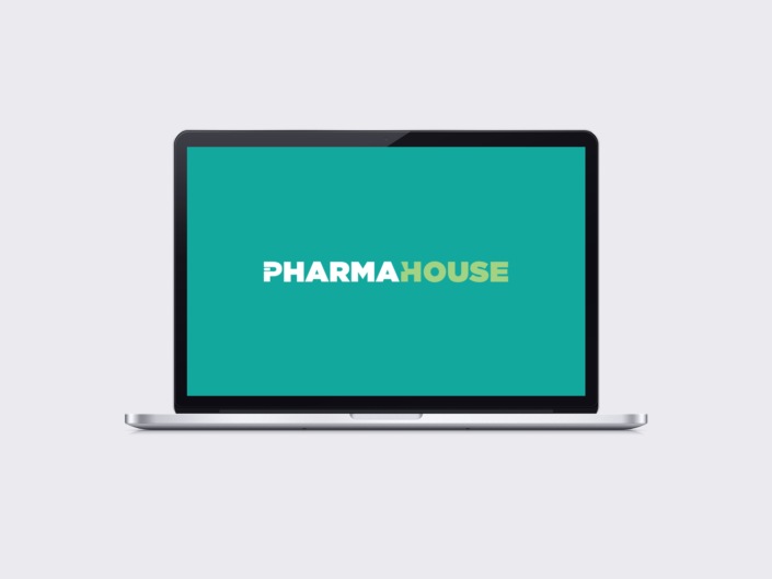 Pharmahouse logo design by 30two shown on macbook screen
